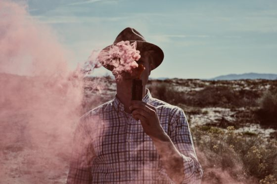 Man In Hat Vaping