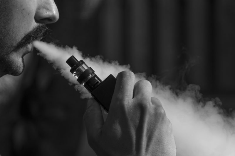 Man Vaping E Liquid